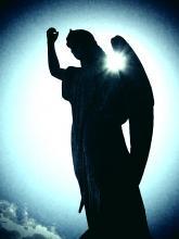 Angel raising a fist. Image via Neil Lang/shutterstock.com