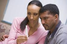 Couple with negative pregnancy test, Monkey Business Images / Shutterstock.com