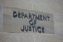 Sign on the exterior of the Department of Justice. Photo courtesy kenkistler/shu