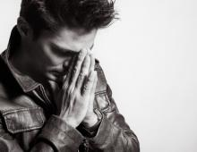 Man praying, KieferPix / Shutterstock.com