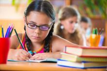 A girl studies in school. Image courtesy Olesya Feketa/shutterstock.com
