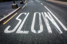 Slow down sign, Semmick Photo / Shutterstock.com