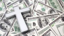 Cross on top of $100 bills, StockThings / Shutterstock.com