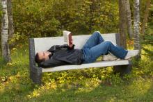 Man reading in the park, dragon_fang / Shutterstock.com