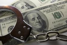Handcuffs and money, Siarhei Fedarenka /Shutterstock.com
