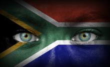 South African flag over human face, Aleksandar Mijatovic / Shutterstock.com