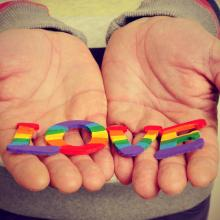 "Hands holding the word ""Love."" Image courtesy nito/shutterstock.com"