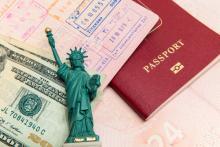 Passport visa and money. Image courtesy mariakraynova/shutterstock.com.