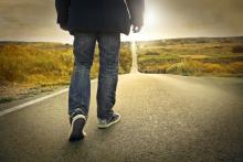 Traveling on a long road. Image courtesy Ollyy/shutterstock.com
