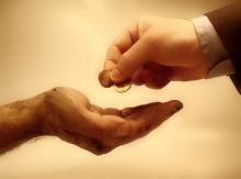 Giving money photo, Konstantinos Kokkinis / Shutterstock.com