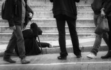 Beggar among a crowd, Lasse Ansaharju / Shutterstock.com