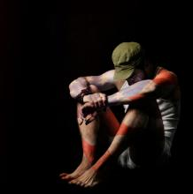 Solider in isolation painted with an American flag. Image courtesy CURAphotograp