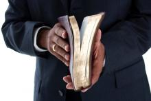 Pastor with Bible, Rob Marmion / Shutterstock.com