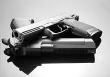 Handgun photo, Nomad_Soul / Shutterstock.com