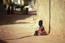 Photo: Child sitting in the dust in  Attila JANDI / Shutterstock.com