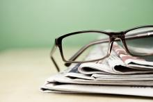 Stack of newspapers photo, kret87 / Shutterstock.com