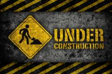 Under construction sign, L.Watcharapol / Shutterstock.com