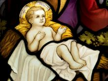 Photo: Stained glass image of baby Jesus, © Jurand / Shutterstock.com