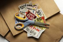 Photo: Clipping coupons, Jim Barber  / Shutterstock.com