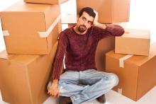 Man among moving boxes, William Perugini / Shutterstock.com