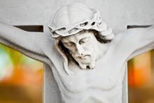 Jesus bows his head on the cross. Image courtesy Kamira/shutterstock.com