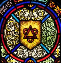 Stained glass window representing the Trinity, Nancy Bauer / Shutterstock.com