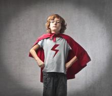 Child in superhero suit, olly / Shutterstock.com