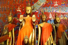 Buddha statues in Wat Xieng, MJ Prototype / Shutterstock.com
