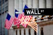 Wall Street sign outside New York Stock Exchange, Stuart Monk / Shutterstock.com
