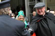 Cardinal Timothy M. Dolan greets a firefighter at the annual St. Patrick's Day p