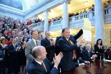 Utah Gov. Gary Herbert displays Senate Bill 296 after signing it into state law.