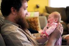 Eric Brown holds his two-month-old daughter, Pearl Joy, on Oct. 1, 2012.