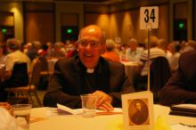 Seattle Archbishop J. Peter Sartain, LCWR's apostolic delegate, is seen at the g