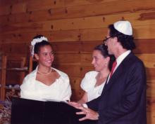 Lacey Schwartz at her Bat Mitzvah with her parents. Image courtesy Lacey Schwart