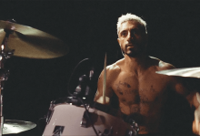 A drummer sits at his drum set in a scene from 'Sound of Metal'
