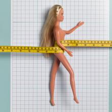 Child's doll with tape measure, Peter Dazeley / Getty Images