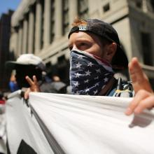 Protestors march in Chicago on Sunday during the NATO summit there. Photo by Spe