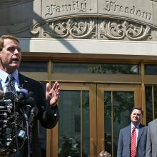 Perkins speaks to reporters outside FRC's headquarters in Washington, D.C.
