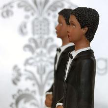 Two grooms wedding cake topper. Image via Wylio, http://bit.ly/x8aDYB.