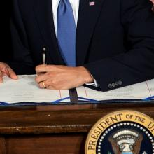 President Barack Obama signs the health insurance reform bill, March 23, 2010. P