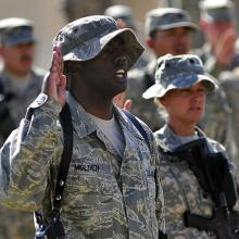 Tech. Sgt. LaMarcus Molden recites the oath of enlistment at Al Asad Air Base in