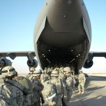 U.S. troops head to Iraq, 2006. Image via Wiki Commons http://bit.ly/w1FpAB