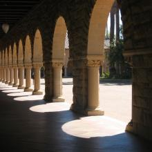 Arches of the Quad at Stanford University. Image via Wiki Commons
