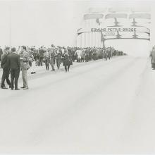 Marchers stopped at Edmund Pettus bridge. Image via Penn State Special Collectio