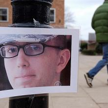 Bradley Manning photo hangs on lightpost, photo by savebradley / Flickr.com