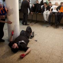 Drunk man during Purim festivities in Israel, 2011. Photo by Uriel Sinai/Getty I