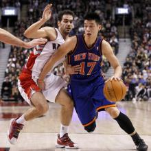Jeremy Lin drives to the basket against the Toronto Raptors, Feb. 14, 2012. Phot