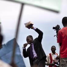 Man holding Bible speaks during anti-homosexuality rally in Kamapala, Uganda