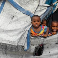 Children in a tent, Haiti 2014. Image courtesy Chuck Bigger, Compassion Internat