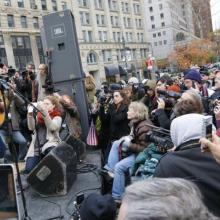 Joan Baez performs for Occupy Wall Street. Image from ph.cdn.photos.upi.com